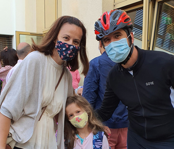 The Milos family with their masks